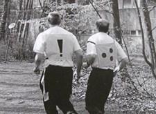 Blinde atleet met begeleider
