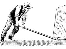 Man tilt met een hefboom een zwaar steenblok op